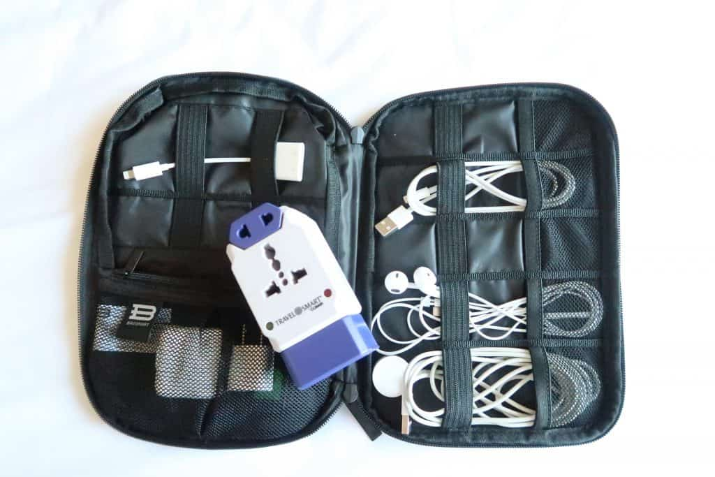 BAGSMART bag packed with cords and travel adapter.