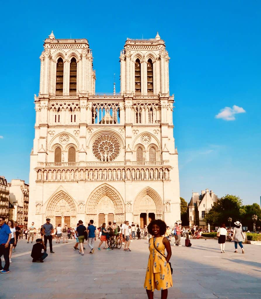 Woman stands outside Notre Dame