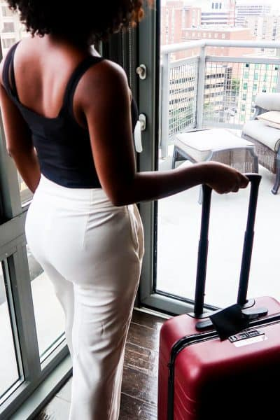 Woman with away luggage