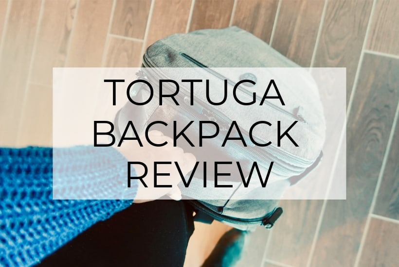 tortuga backpack in hand