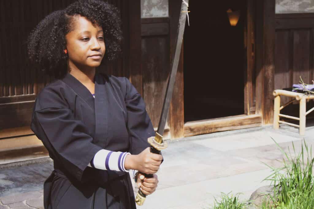 Woman practicing the ways of the samurai with a katana