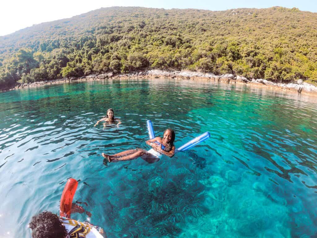 Woman swimming off Dalmatian coast