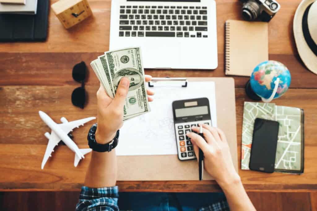Man building travel budget.