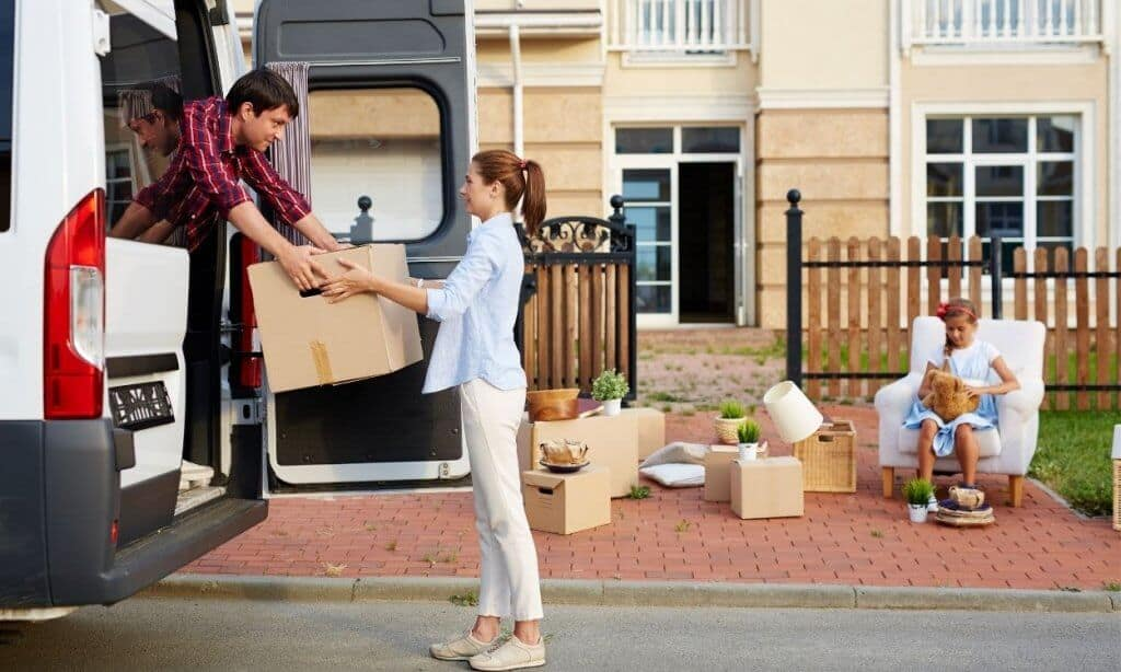 Man helping woman with moving boxes.